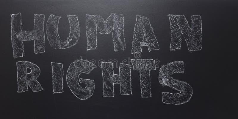 Das Wort geschrieben - Menschenrechte auf der Tafel stockbilder