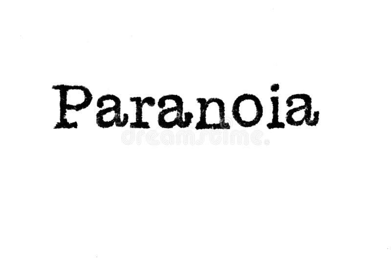 Das Wort ` Paranoia ` von einer Schreibmaschine auf Weiß stockfoto