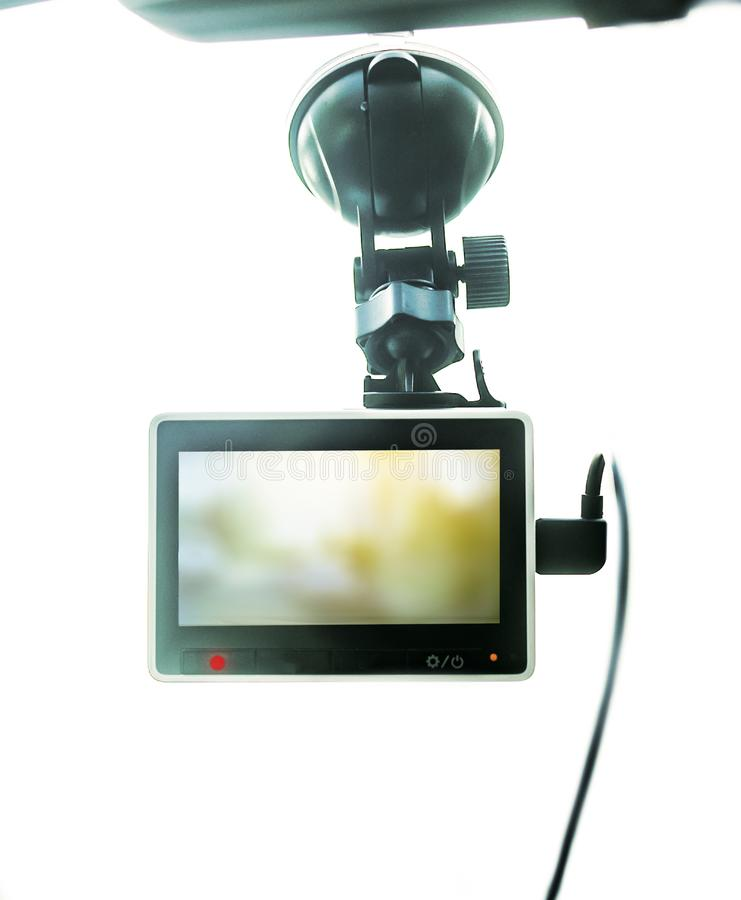 Dash cam frontview. Hanging on a windshield, white background stock photography