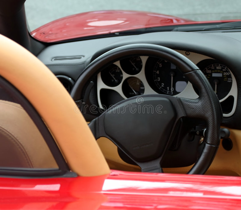 Dash of red exotic sports car. Dash board of red exotic sports car royalty free stock photos