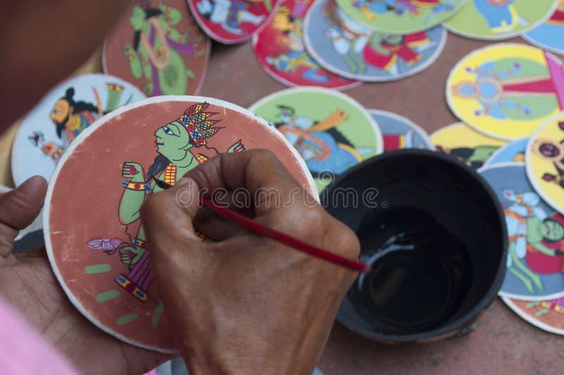 Dashavatara cards, artwork, bishnupur, India. BISHNUPUR, WEST BENGAL / INDIA - OCTOBER 24, 2013: Artisan making Dashavatara cards. They are famous artwork royalty free stock images