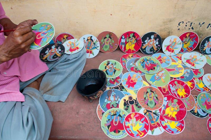 Dashavatara cards, artwork, bishnupur, India. BISHNUPUR, WEST BENGAL / INDIA - OCTOBER 24, 2013: Artisan making Dashavatara cards. They are famous artwork stock image