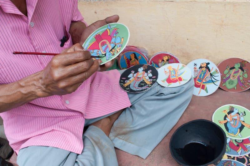 Dashavatara cards, artwork, bishnupur, India. BISHNUPUR, WEST BENGAL / INDIA - OCTOBER 24, 2013: Artisan making Dashavatara cards. They are famous artwork royalty free stock photos