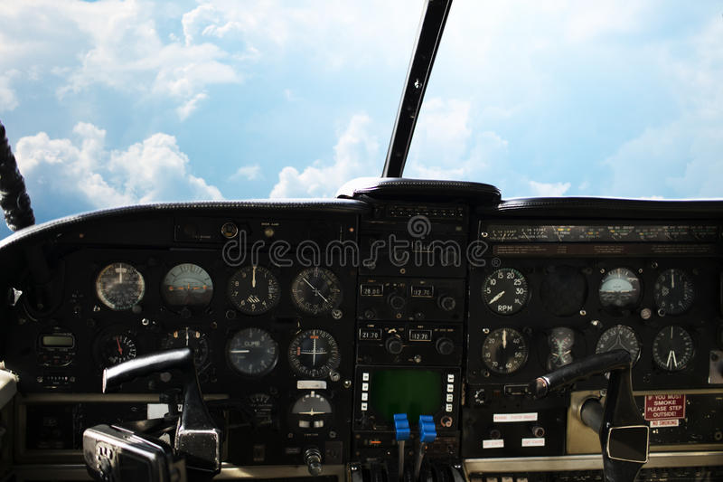 Dashboard in airplane cockpit and view of sky stock photo