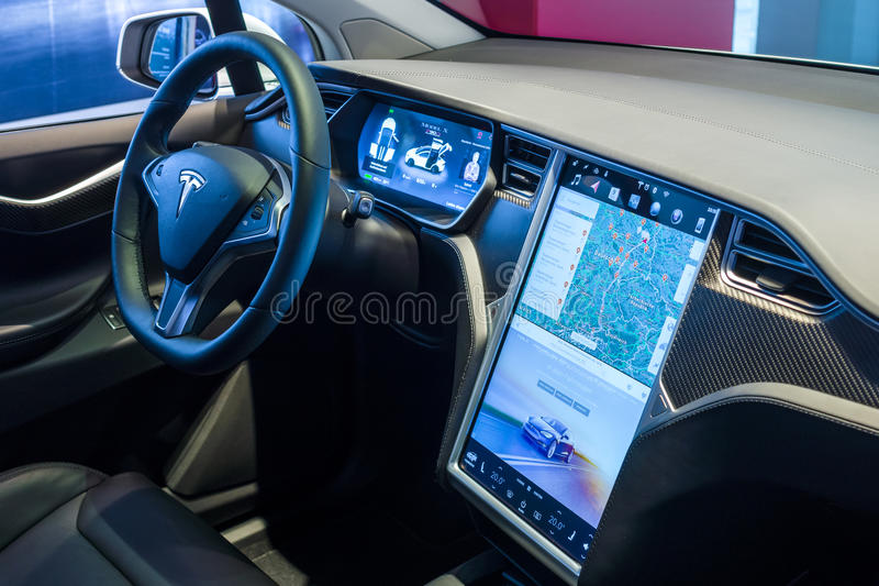 The dashboard of a full-sized, all-electric, luxury, crossover SUV Tesla Model X. BERLIN - NOVEMBER 09, 2016: Showroom. The dashboard of a full-sized, all royalty free stock photo