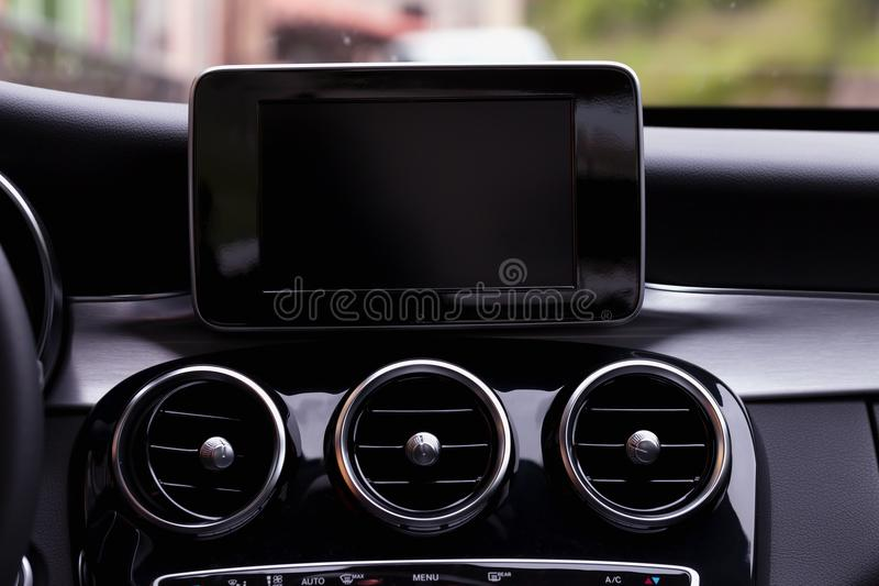 Dashboard with GPS navigation system of a modern car. Dashboard with GPS navigation system of a modern black car stock image