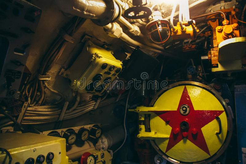 Dashboard, valves and appliances in old decommissioned Russian diesel submarine royalty free stock images