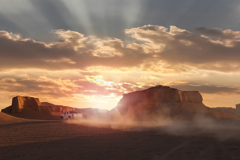 Dasht e Lut desert in Iran. The car in motion on the background of the sunset. Wild nature of Persia.  stock photography