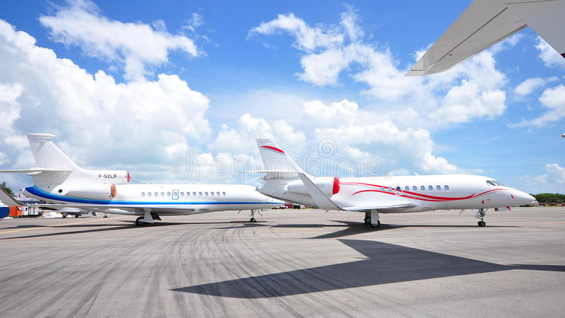 Dassault Falcon 2000LX and Falcon 7X business jets on display at Singapore Airshow 2012 royalty free stock photography