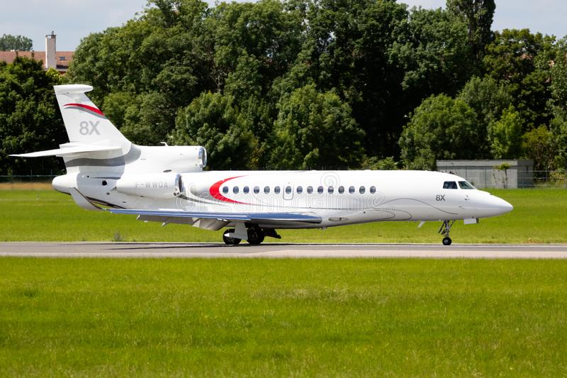 Dassault Falcon 8X business jet. LE BOURGET PARIS - JUN 21, 2019: New Dassault Falcon 8X business jet on the runway during the Paris Air Show france white fly royalty free stock photos