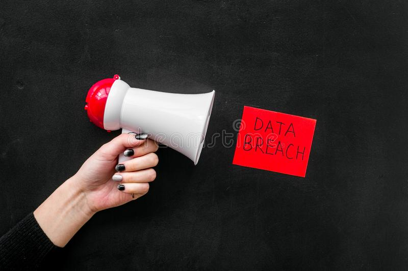 Data breach concept with megaphone on black background top view stock photos