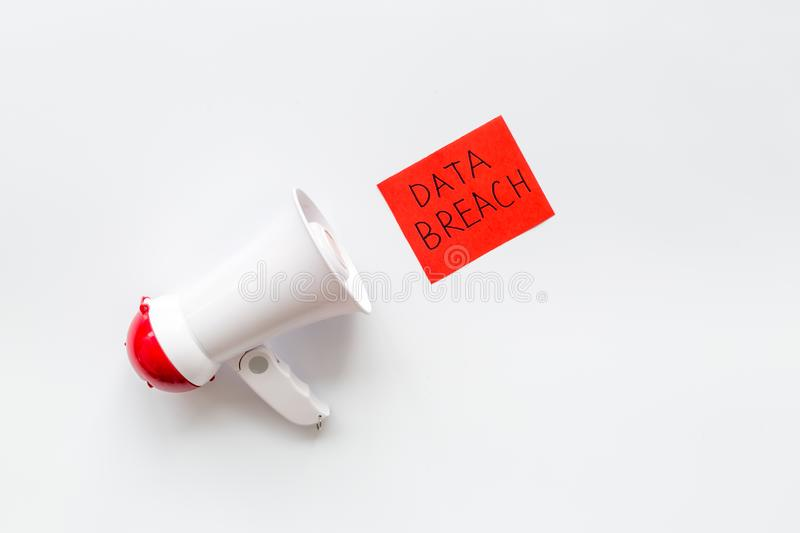 Data breach concept with megaphone on white background top view stock images