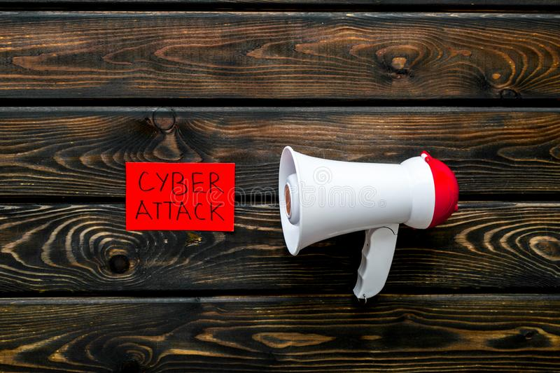 Data breach concept with megaphone on wooden background top view. Data breach and cyber attack concept with megaphone on wooden background top view royalty free stock image