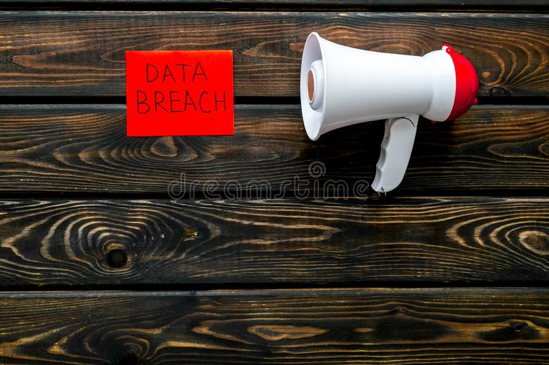 Data breach concept with megaphone on wooden background top view mock up. Datd breach concept with megaphone on wooden office desk background top view mock up stock photo