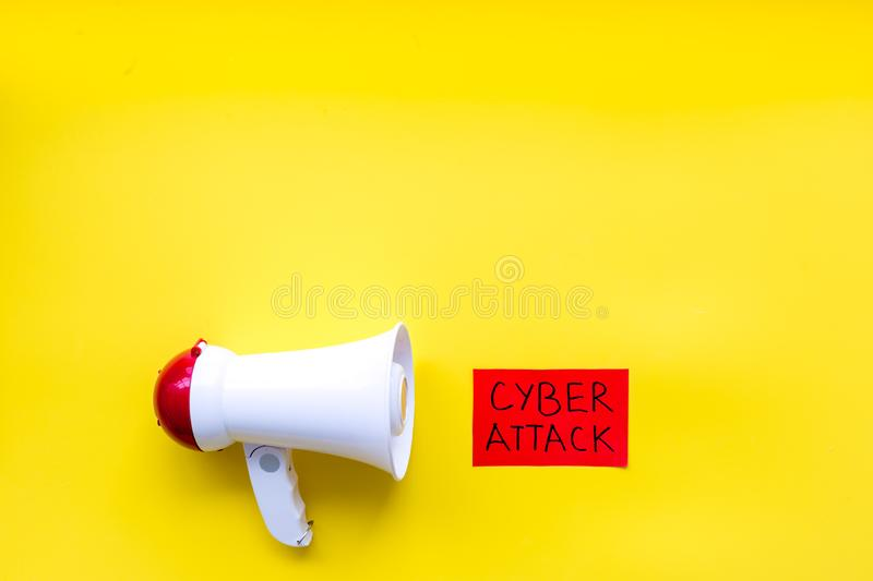 Data breach concept with megaphone on yellow background top view mockup. Data breach and cyber attack concept with megaphone on yellow background top view mockup royalty free stock photography