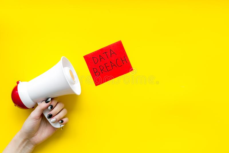 Data breach concept with megaphone on yellow background top view mockup stock photos