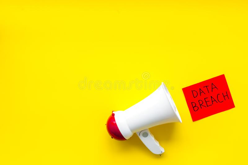 Data breach copy with speaking trumpet on yellow background top view copyspace. Data breach copy with speaking trumpet on yellow office desk background top view royalty free stock photos