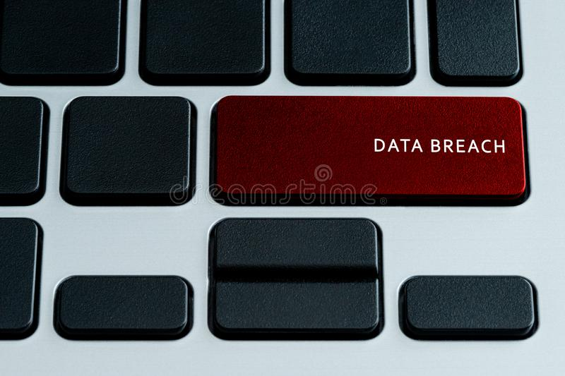 Data Breach on keyboard. Data Breach on laptop keyboard.  Isolated text on theme of internet security stock photography