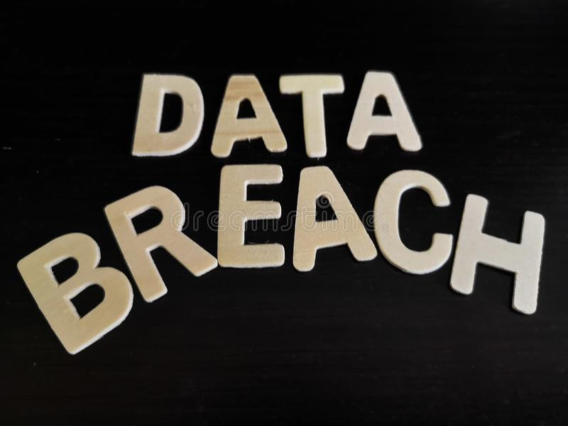 Isolated word of data breach with a dark background. Data breach technology royalty free stock photography