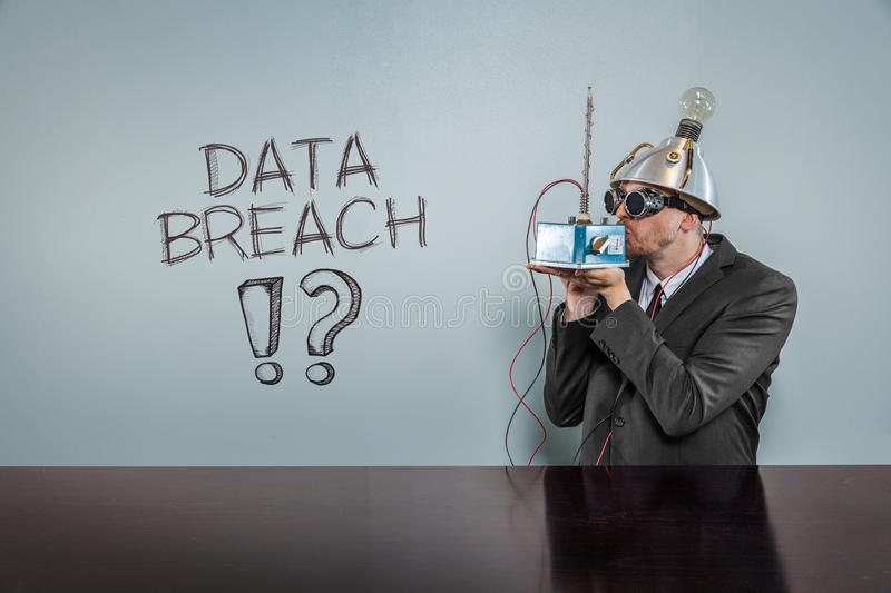 Data breach text with vintage businessman. Kissing machine royalty free stock image