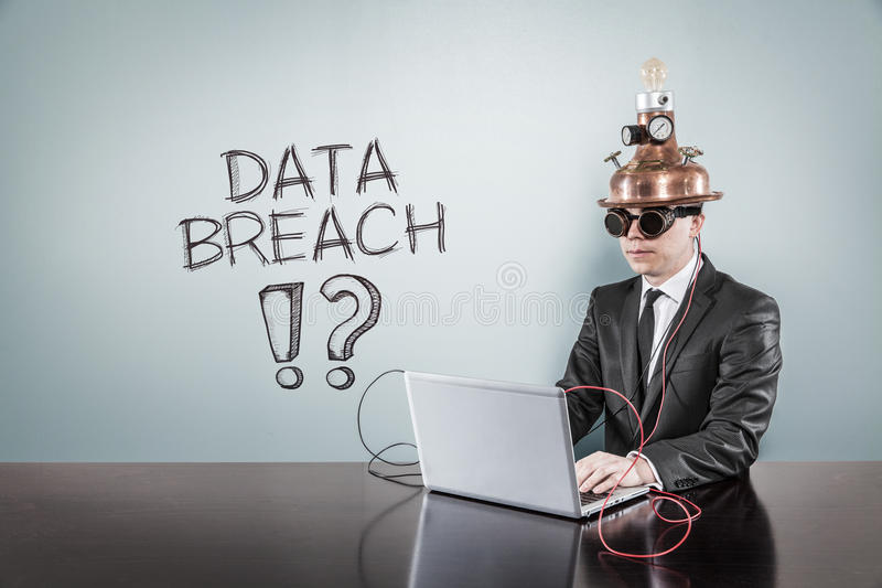 Data breach text with vintage businessman using laptop. At office royalty free stock images