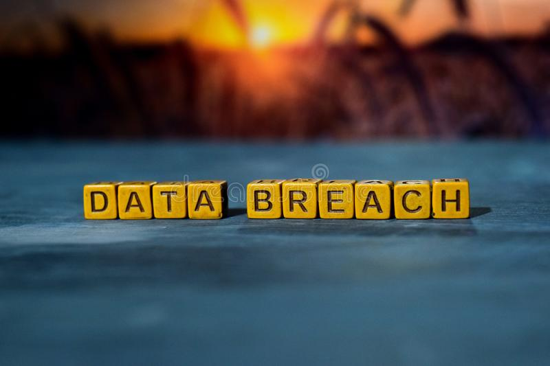 Data breach on wooden blocks. Cross processed image with bokeh background stock photos
