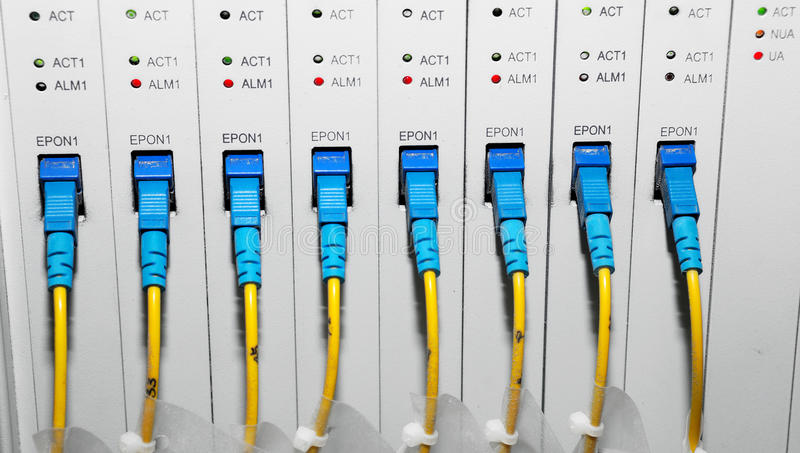 Data center. A shot of network cables and servers in a technology data center stock images