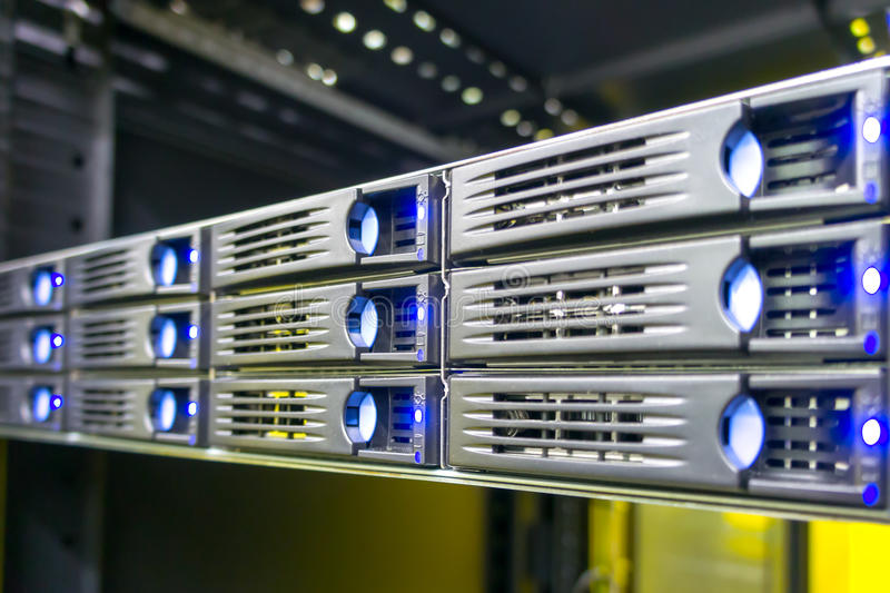 Data center rack with hard drives stock image