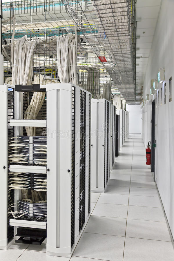 Data Centre Half walkway. ICT data centre IT infrastructure of a big scale industrial server room with lots of telecom and computer equipment mounted in racks stock photo