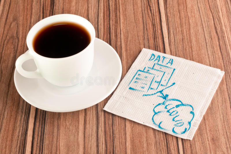 Data in the cloud on a napkin royalty free stock photography
