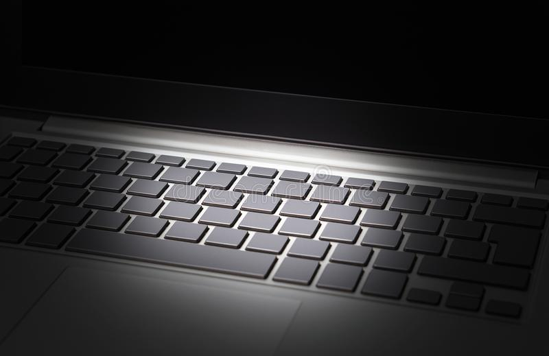 Data and cyber security threat concept. Online financial crime, identity theft and internet scam. Laptop computer keyboard in spotlight. Empty blank buttons stock image