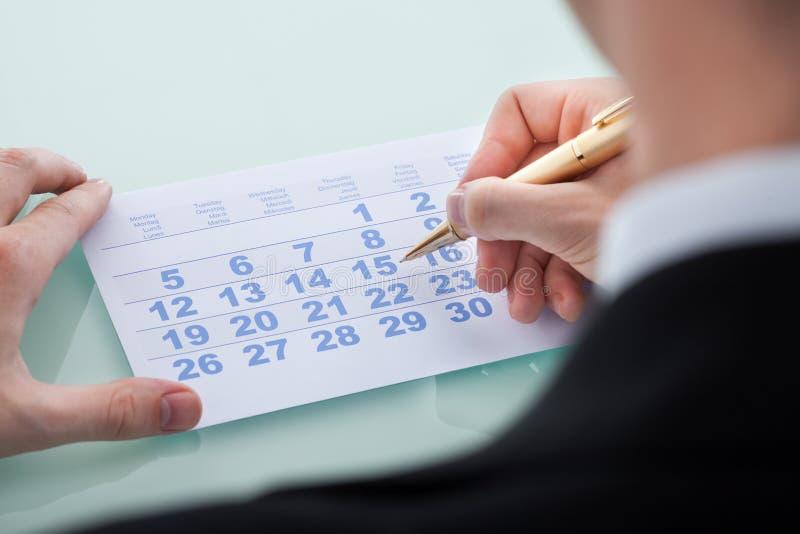 Data 15 da marcação da mão no calendário fotos de stock royalty free