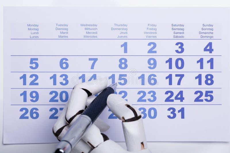 Data da marcação do robô no calendário imagem de stock