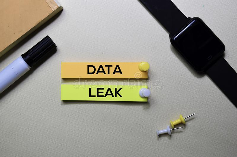 Data Leak text on sticky notes isolated on office desk royalty free stock photo