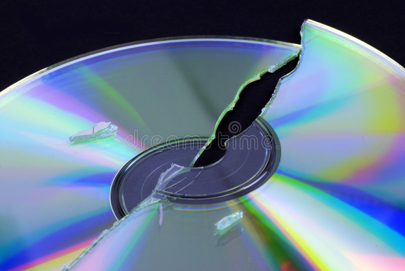Data loss. Broken CD or DVD isolated on black ground stock image