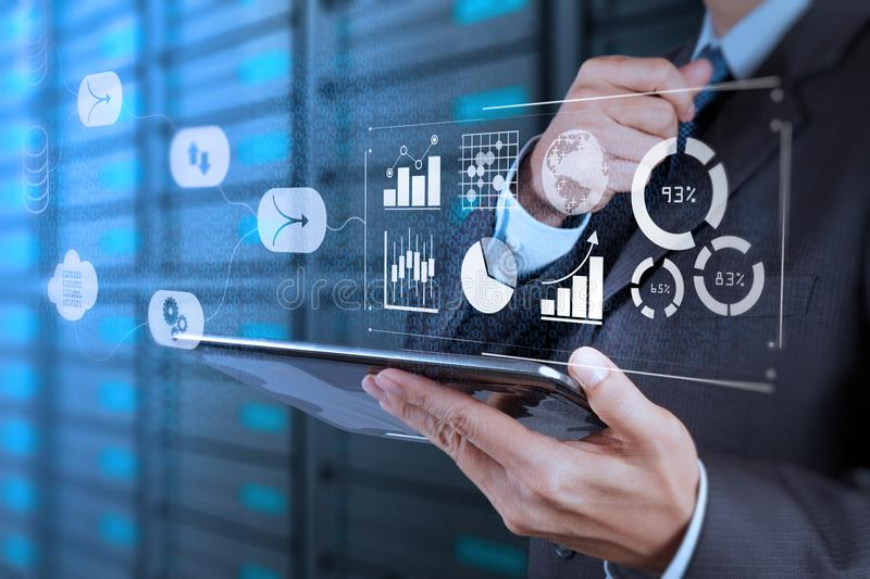 Business data analytics management with connected gear cogs with KPI financial charts royalty free stock photo