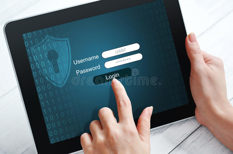 Data protection concept. Female hands using tablet pc protected with password royalty free stock image