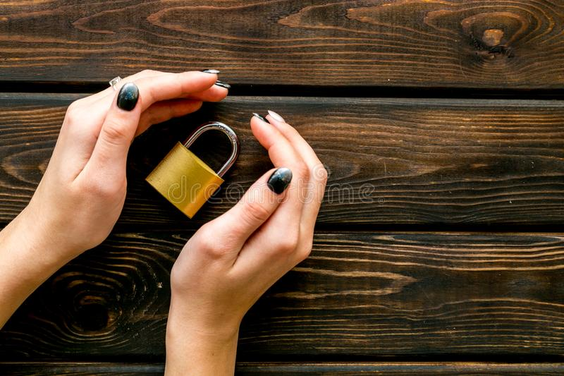 Data protection concept with locker in hands on wooden background top view. Data protection concept with locker in hands on wooden oficce desk background top stock photos