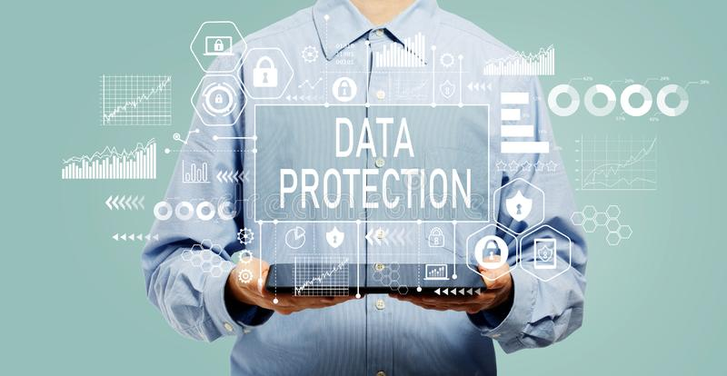Data protection concept with man holding a tablet stock photo