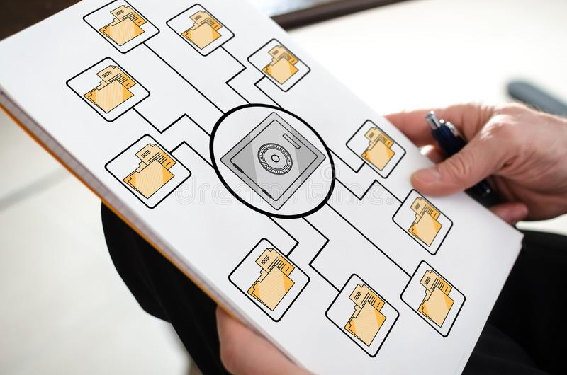 Data security concept on a paper. Held by a hand stock photography