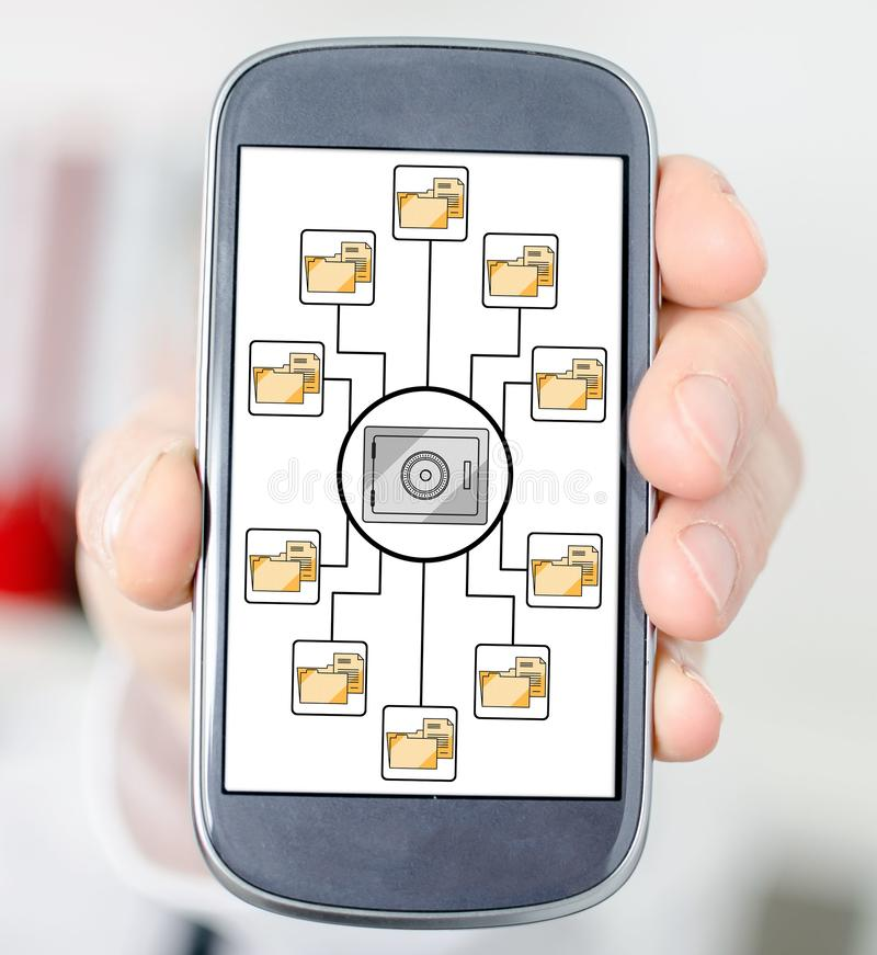 Data security concept on a smartphone. Hand holding a smartphone with data security concept stock photos