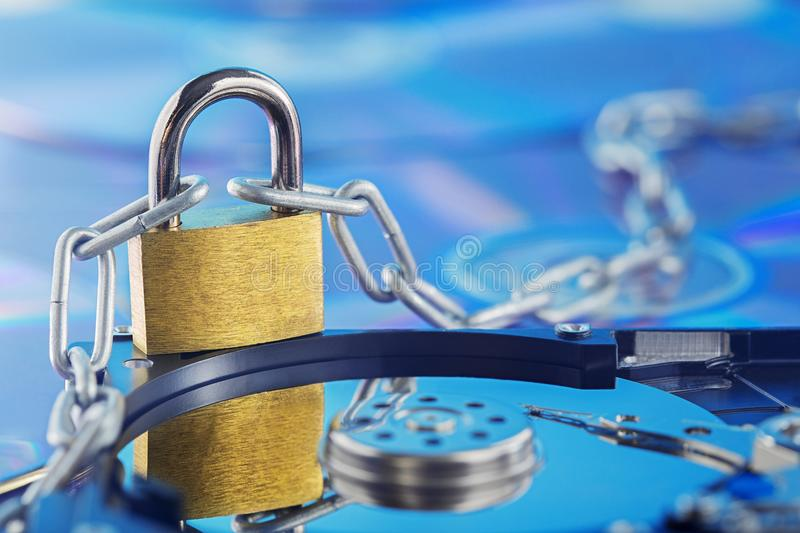 Data security, information protection and personal information defense. Padlock on hard drive disk at CD disk background. Concept. Of digital data and royalty free stock photos