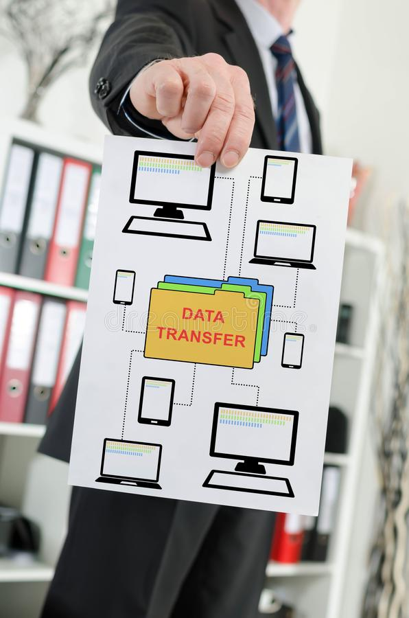 Data transfer concept shown by a businessman royalty free stock images