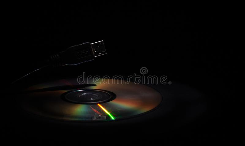 Data transfer, hacking information, CD-compact disc and USB-input royalty free stock photo