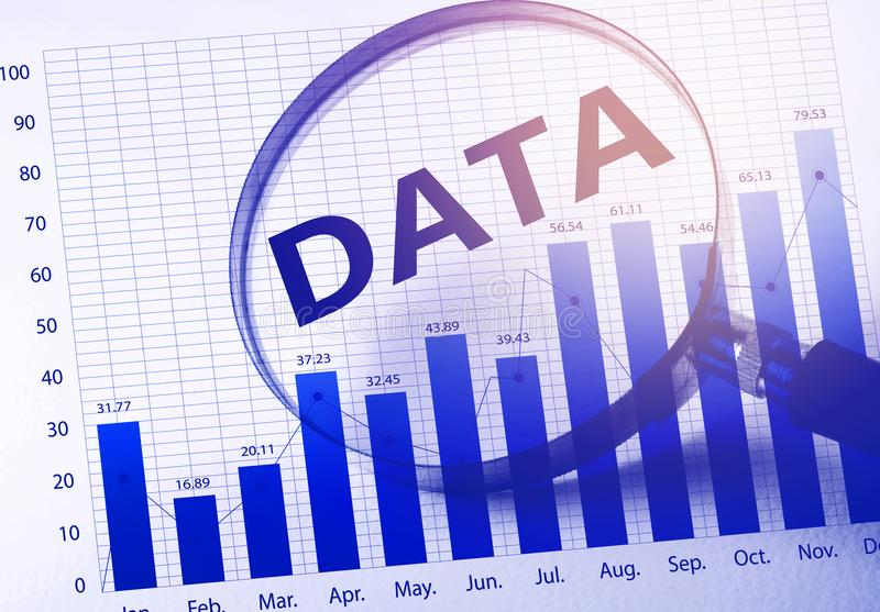 Data word with Magnifying glass and business growth. Graphfinancial graph.For business success concept stock photo