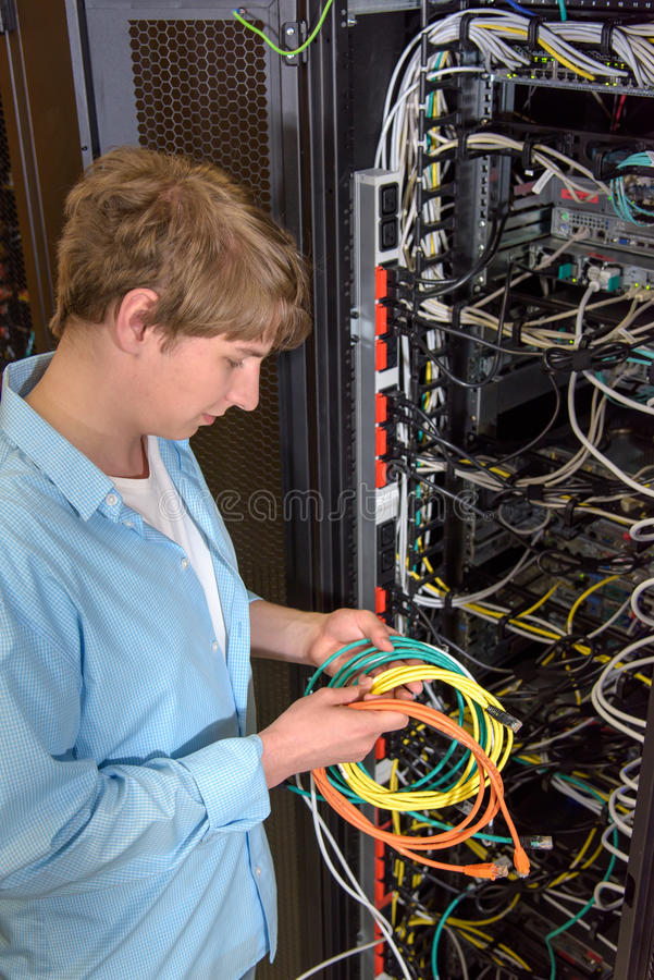 Datacenter engineer with network cables stock photography
