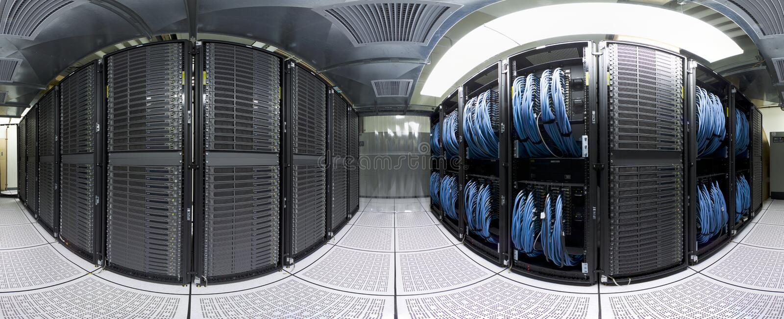 Datacenter panorama. An unusual view of a supercomputer (datacenter) - full 360 degrees panorama. Two racks filled with servers and fast interconnect switches royalty free stock image