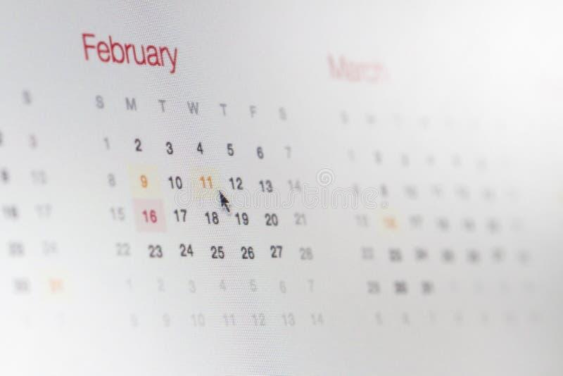 Datas de calendário do tela de computador imagem de stock royalty free