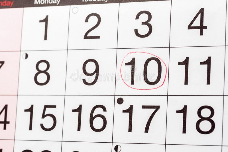 Date Circled in a Calendar Page. Close up of a Calendar Page with a Date Circled in Red stock photography
