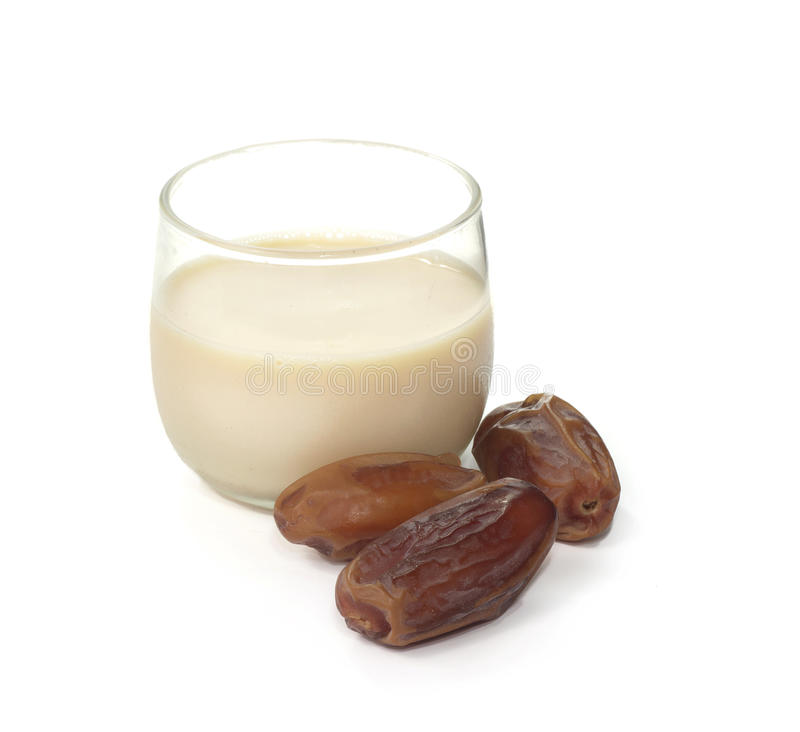 Date con latte fotografia stock libera da diritti